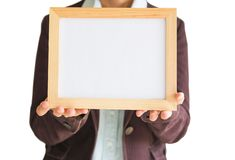 Blank wooden photo Frame in the woman`s hand isolated on white background .Blank space for text and images. Of file with Clipping Path stock photography