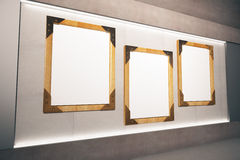 Blank wooden picture frames on beige wall in empty room, mock up royalty free illustration