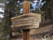 Blank Wooden Sign. Rustic blank wooden sign on a hiking trail high in the mountains above Southern California Royalty Free Stock Photo