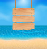 Blank wooden sign on beach, natural seascape Stock Photos