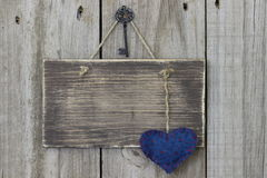 Blank wooden sign with blue calico heart Royalty Free Stock Photos
