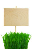 Blank wooden Sign with green Grass / isolated Royalty Free Stock Image