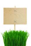 Blank wooden Sign with green Grass / isolated Royalty Free Stock Photography
