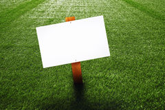 Blank wooden sign on the lawn Stock Photos