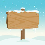 Blank wooden sign in the snow Royalty Free Stock Image