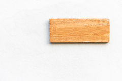 Blank wooden sign on white concrete wall Royalty Free Stock Photos
