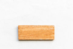 Blank wooden sign on white concrete wall Royalty Free Stock Images