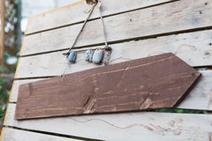 Blank wooden signboard hanging on a rope Royalty Free Stock Image