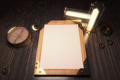 Blank wooden steampunk picture frame with vintage lamps, compass Royalty Free Stock Photo