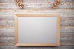 Blank wooden steampunk picture frame on wooden wall Royalty Free Stock Photo