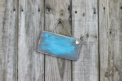Blank worn blue sign with heart hanging on wood fence Stock Photo
