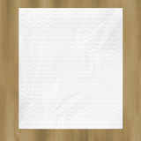 Blank wrinkled paper on wood board. Royalty Free Stock Images