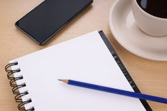 Blank writing pad on desk Stock Photography