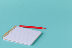 Blank writing pad for ideas and inspiration on colored background Stock Images