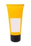 Blank yellow cream tube on white background Stock Photos