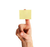 Blank yellow note on finger Stock Image