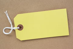 Yellow Paper Luggage Tag Stock Photo