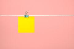 Blank yellow paper note on the string Stock Images