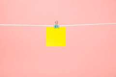 Blank yellow paper note on the string Stock Photo