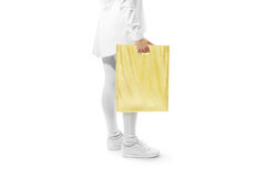 Blank yellow plastic bag mockup holding hand Royalty Free Stock Photography