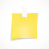Blank yellow post it note. Isolated on white background Royalty Free Stock Photography