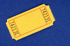 Blank yellow raffle ticket on a blue background Stock Image