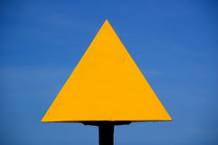 Blank yellow sign. Blank yellow triangle with blue sky background Royalty Free Stock Image