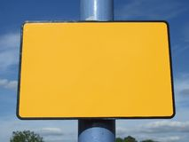 Blank yellow sign. On blue pole, space for your massage Stock Photo