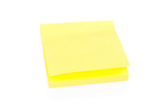 Blank yellow sticky note on block Stock Photos
