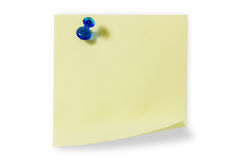 Sticky note with blue push pin. Blank yellow sticky note with blue push pin isolated on white background stock photo