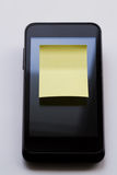 Blank yellow sticky note. Photo serie about motivational stickers on mobile phone Stock Photos