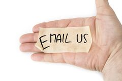 Blank  yellow sticky tape on the palm . Email  us concept. Stock Photography