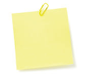 Blank Yellow To-Do List Post-It Style sticker, paperclip, isolated copy space, large detailed closeup Royalty Free Stock Image