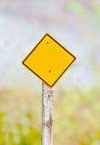 Blank yellow warning sign Stock Photography