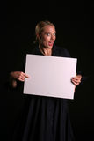 Blank for your text. A young blondie woman holds a blank white sign and whinks at you the viewer blank for your text stock images