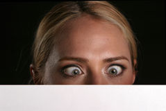 Blank for your text. A young blondie woman holds a blank white sign and whinks at you the viewer blank for your text stock photography