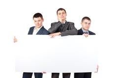 blanka affärsmän rymmer upp stort tecken tre Arkivfoton