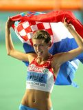 Blanka Vlasic celebrates victory. Blanka Vlasic of Croatia celebrates victory in High Jump Final of the 20th European Athletics Championships at the Olympic Royalty Free Stock Images