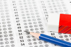 Blanked answer sheet. With eraser focus on pencil Royalty Free Stock Photos