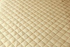 Blanket. Rhomboids blanket in ecru color Stock Photos