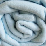 Blanket. One blue blanket without background Stock Photo