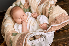 Blanket, basket and baby. Stock Photo