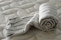 Blanket on bed. A roll of blanket on bed,with beautiful lighting Royalty Free Stock Images
