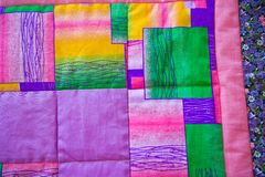 Blanket on a bed from bright pieces of a fabric 3024. Stock Photography