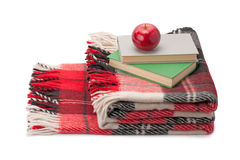 Blanket, books and apple Stock Image