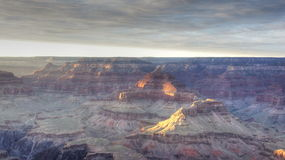 A blanket of clouds put most of the Grand Canyon in shadow. Stock Photos