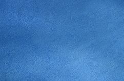 The blanket of furry blue fleece fabric. A background texture of light blue soft plush fleece material.  Stock Photo