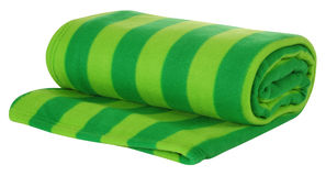 Blanket. Isolated. Rolled up blanket over white background Stock Image