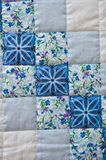 Blanket made manually from fabric slices 2995. Embroidered by dark blue and white patterns a scrappy blanket Royalty Free Stock Image