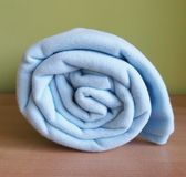 Blanket. One blue blanket with green background Royalty Free Stock Photography